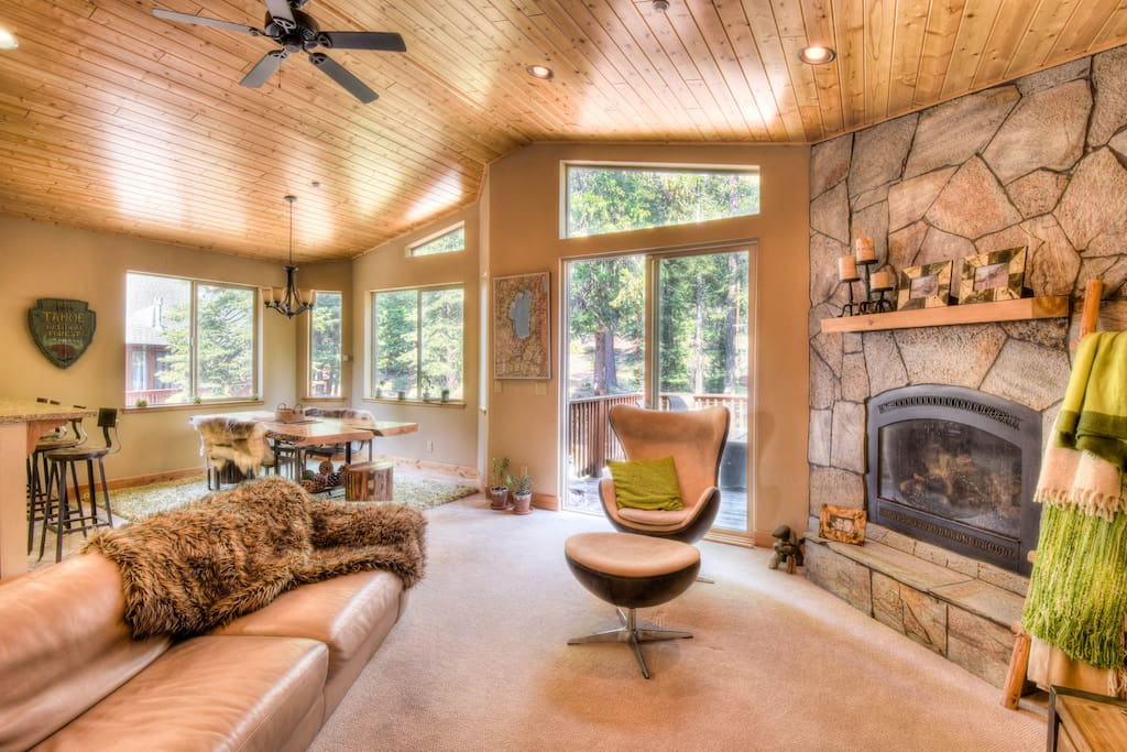 Open and warm living room with high end quality furniture and finishes