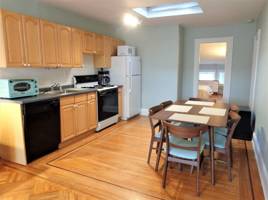 The kitchen has a dishwasher and is fully stocked with all the necessary amenities. The dining area has plenty of seating.