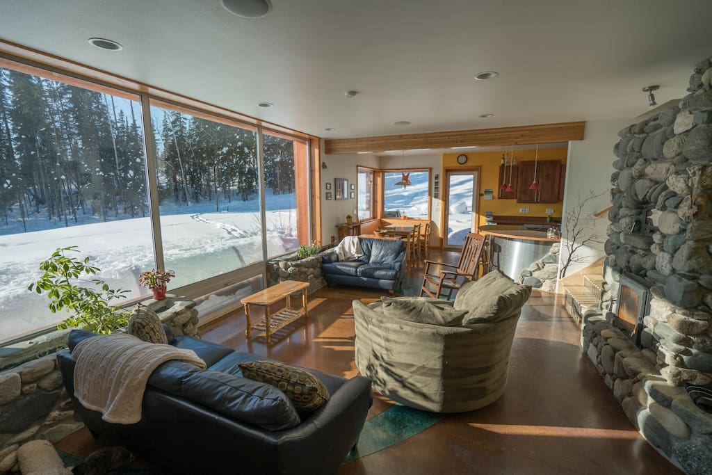 Sun-drenched living room of Fairbanks' Sunrise Home