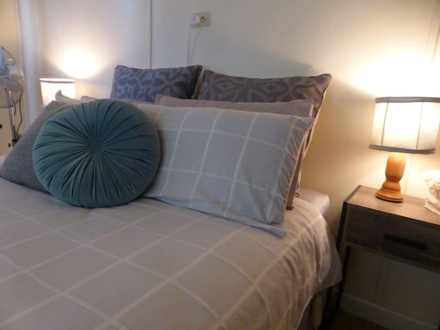 Main bedroom, with queen bed.