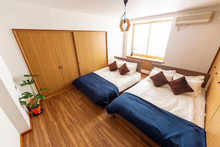 The bedsheet are replaced with clean ones after every check out. The replaced ones are sheets that are cleaned with good fragrance. I want the space to be as luxurious as possible so I bought new beds that match the interior. 2 double sized beds.