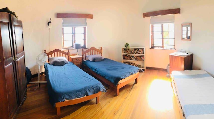 Bedroom 4: 3 single beds, basin. Sea views.