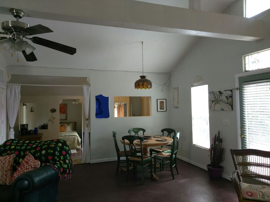 Dining area with open bedroom in the background