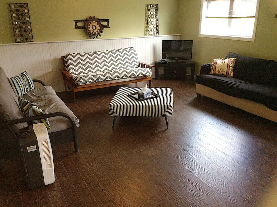 Large living room with 2 futon couches for sleeping!