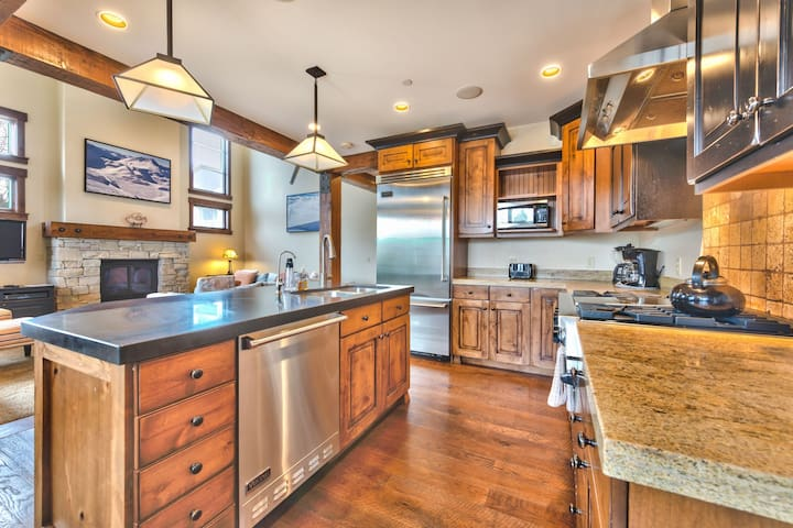 Fully Equipped Gourmet Kitchen with Stainless Steel Appliances and Granite Countertops.  Bar Seating for 3