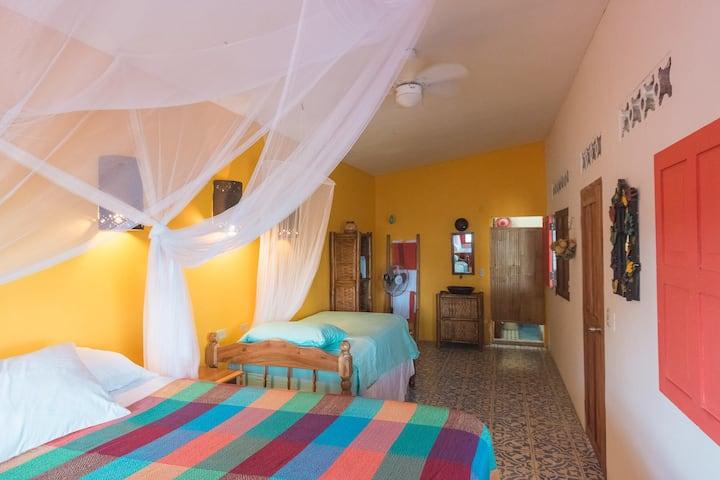 Chocoyo room at Casa de las Aves. Queen & single.