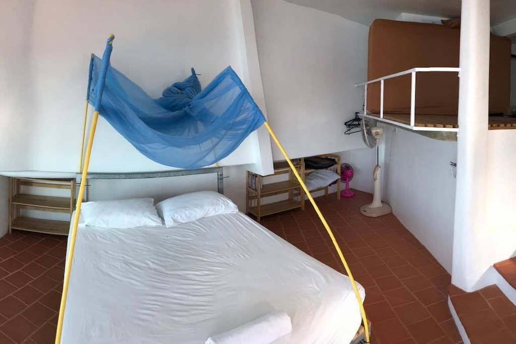 Double bed with removable mosquito net