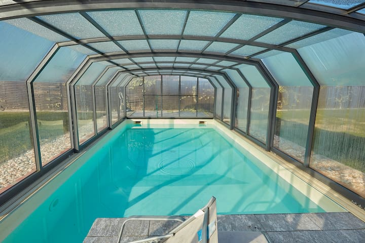 SAFE HOUSE CERTIFIED with covered and heated pool
