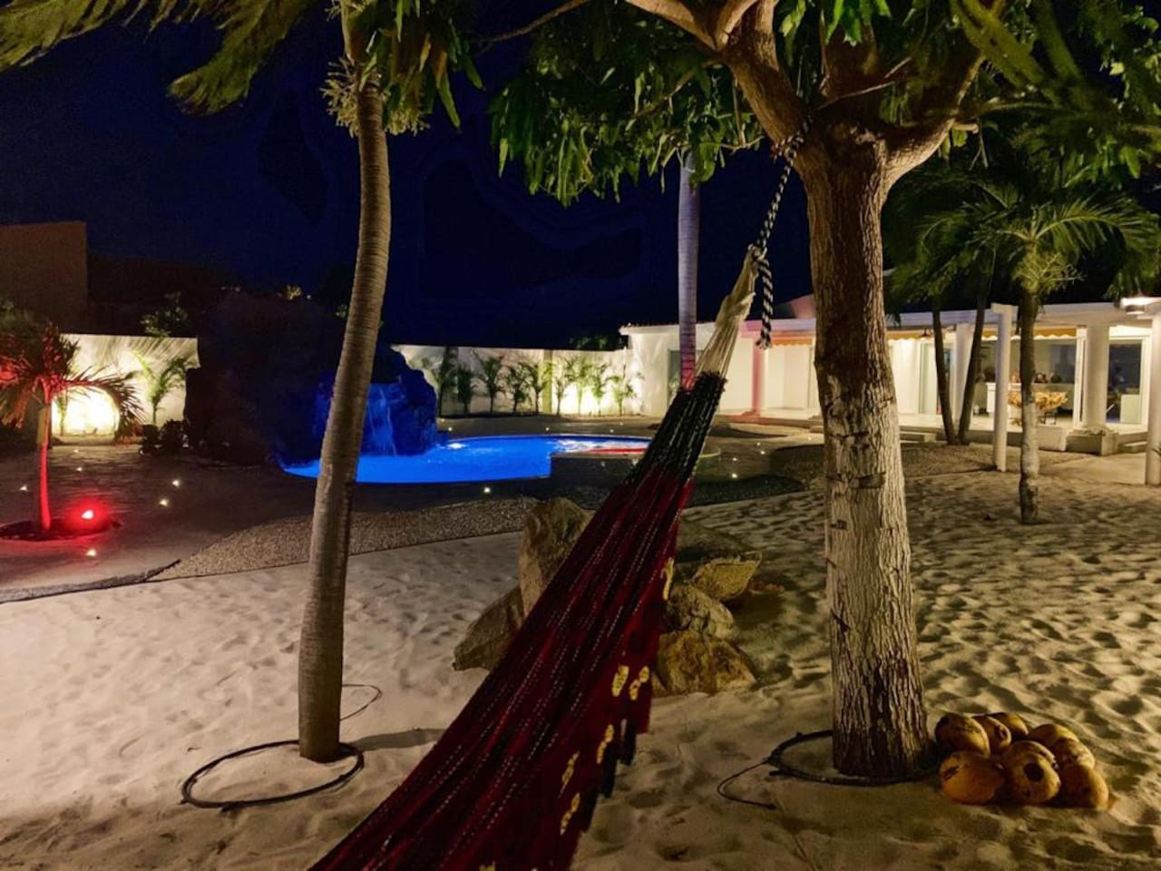 Aruba sand beach area , blue ocean color pool (not salty)area with beautiful palms and mango tree ,waterfall.jacuzzi,and slider to family enjoy , two gazebos one with refrigerator, bbq , tv , dinning table and seats to laying down and relax