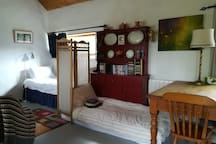 There are times when we host 4 guests at Druid cottage! Usually we have couples but often its a group of family or friends who make a booking. To accommodate them we arrange a single floor mattress, please request when booking for this facility