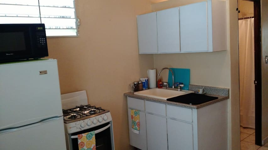 Kitchenette with stove, oven, fridge, microwave & very hot water.