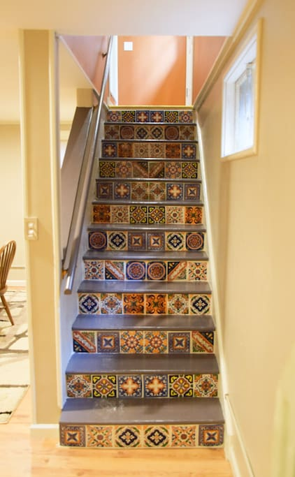 Once you open the door, you'll go down the stairs to get to your space.