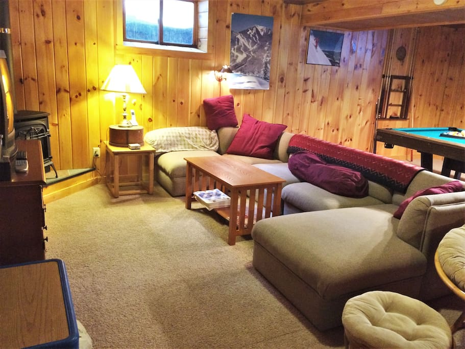 Lots of seating in basement rec room for entertaining/hanging out including Pool table and Foosball table