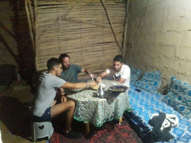 Our guests eating Dinner in our home