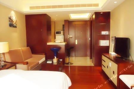 酒店式公寓临近广场 - Chongqing - Hus