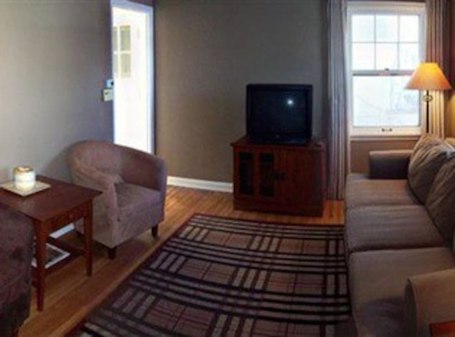 Couches, apple TV, large flatscreen (not pictured), wifi