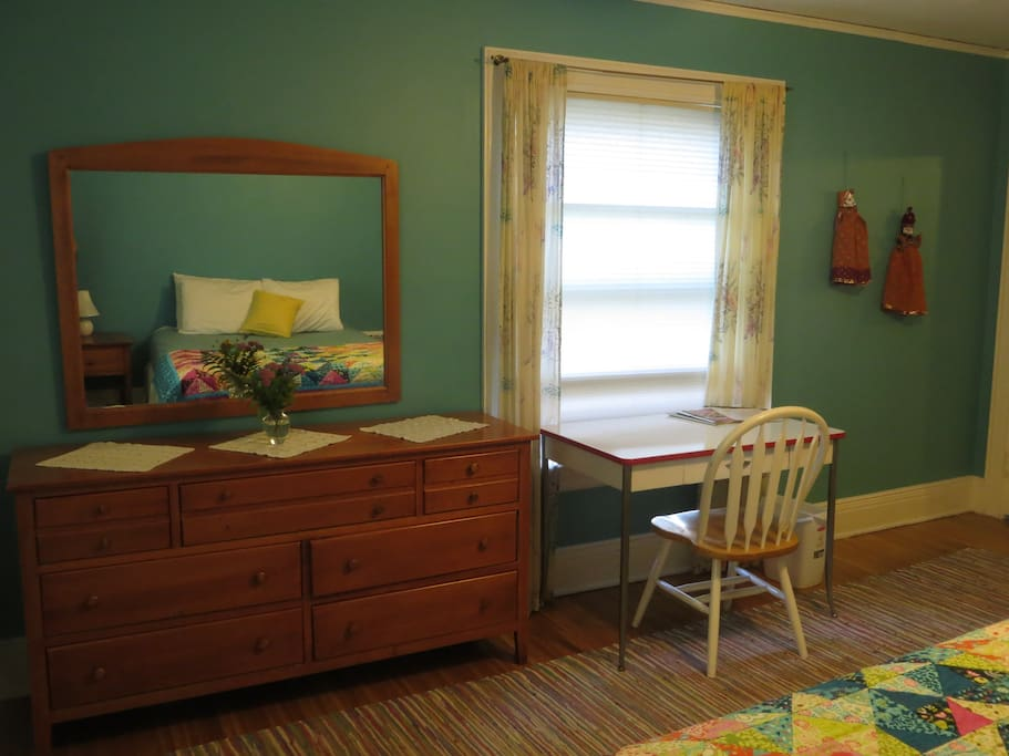 Desk and large dresser. Two windows bring in great light.
