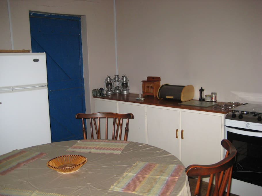 The kitchen is equipped with a gas fridge&freezer, gas stove&oven, cutlery and crockery. There is an inside fireplace/braai.