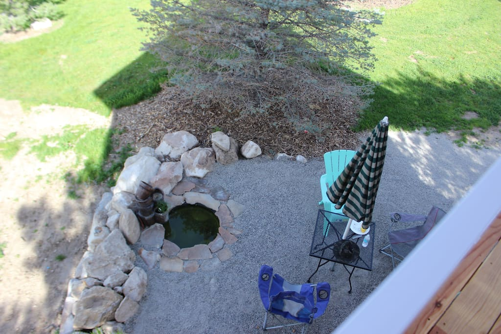 view from deck of water feature and picnic area