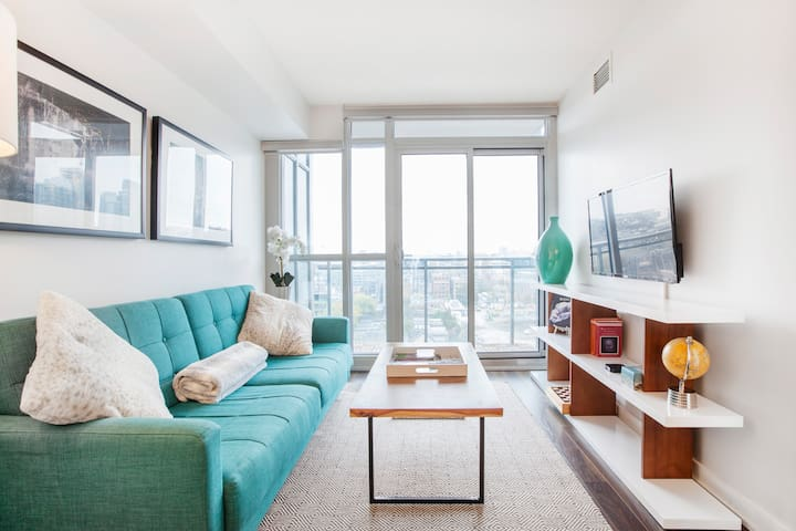 Explore CN Tower from a Chic Downtown Condo