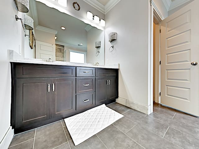 A bright double vanity beckons in the en-suite master bathroom.