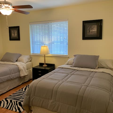 Guest bedroom with two double beds.