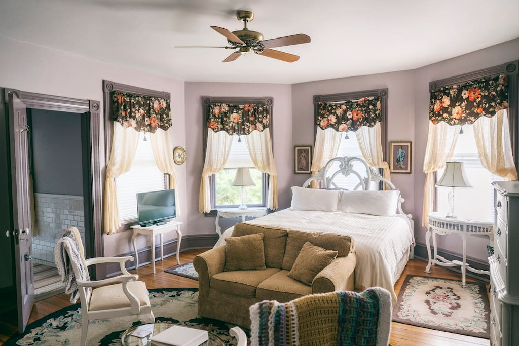 Easton Room - King Bed Surrounded by Antique Bay Windows, Sleeper/Sofa and Seating Area, Entrance to Bathroom