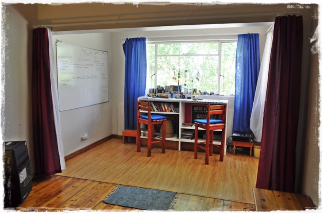 In this photo you can see the second half of the bedroom you will be staying in. The curtains can be closed for some privacy and the little alcove doubles up as a study or small room containing a floor mattress.