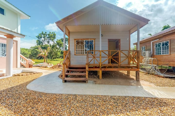 Charming cabana with gated entrance, parking, veranda, partial AC & free WiFi!