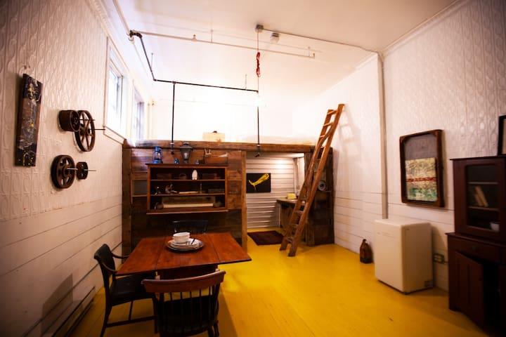 STAY in an Industrial, Cozy & Artsy Sleeping Loft.