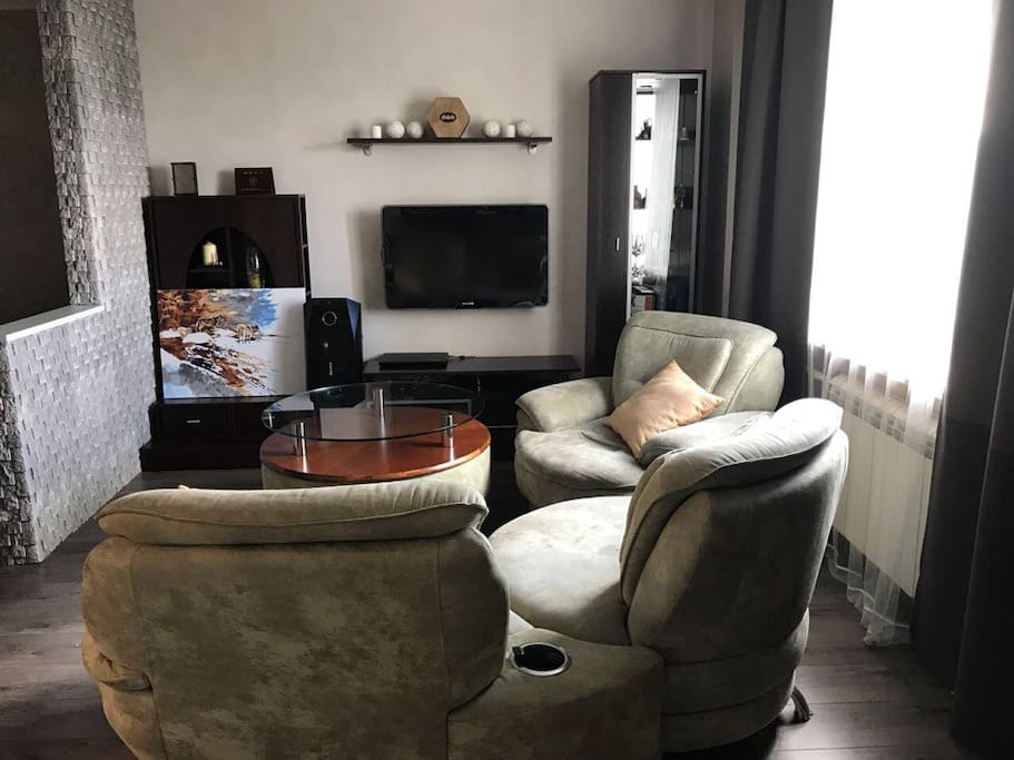 Living room. On request, we will replace three armchairs with a double sofa bed (Free).