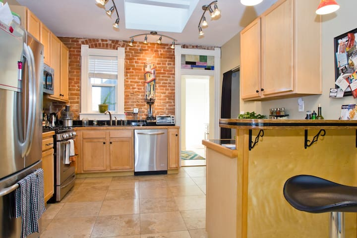 Beautiful, modern kitchen - the brick is from the 1900's!