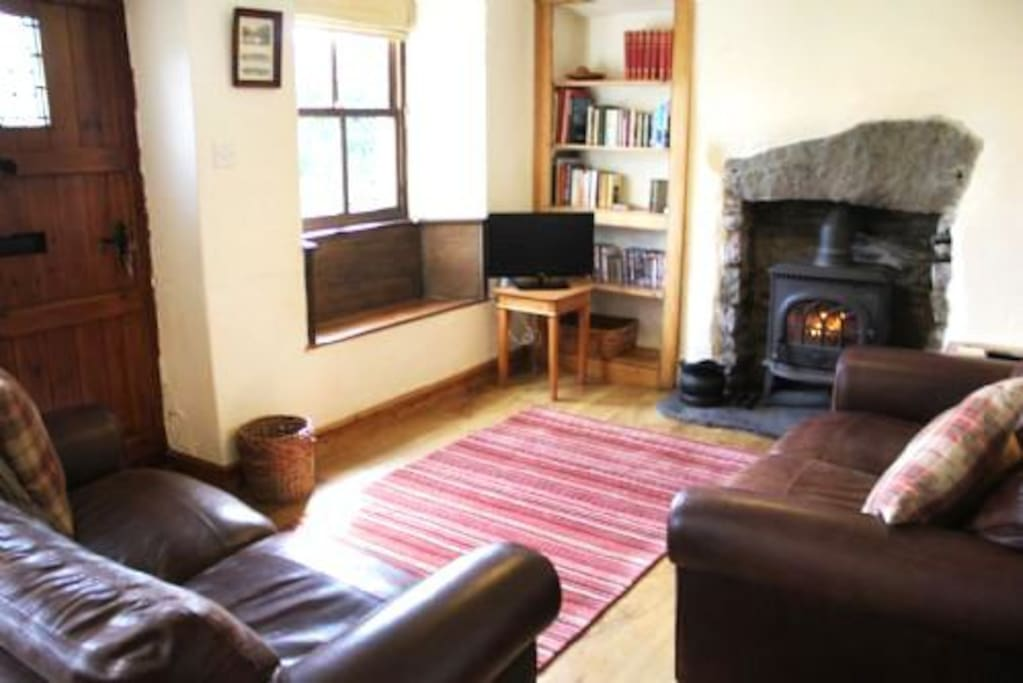 Tanner Croft Cottage, Lounge with wood burning stove, Lakes Cottage Holidays