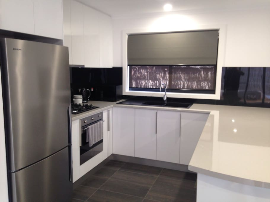 Modern entertainers kitchen with gas cooker