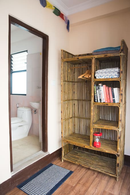 Your ensuite bathroom and rattan wardrobe made locally.