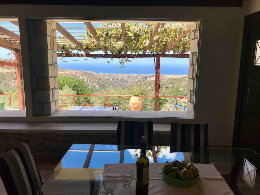 dining room and the living room have view of the canyon and the sea