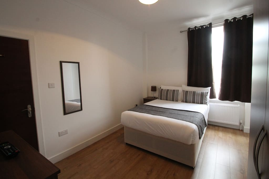 Spacious room with comfortable double bed