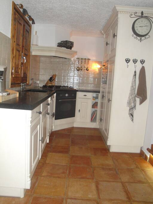 Kitchen with dishwasher oven and magnetron