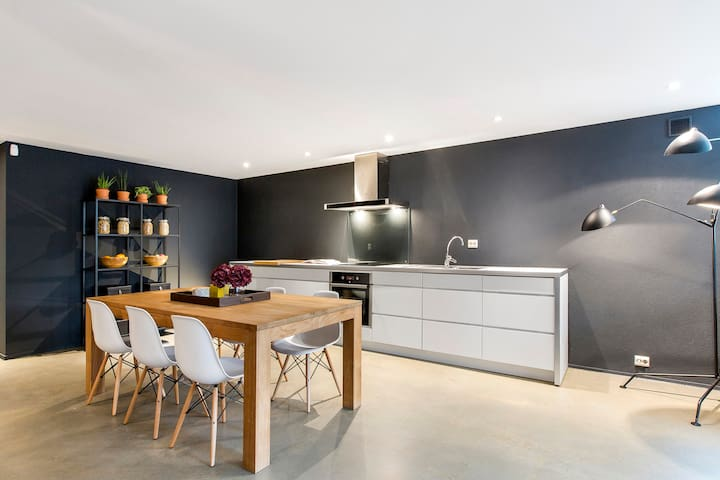 Make yourself a tasty dinner in this minimalistic fully equipped kitchen.
