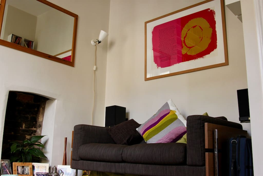 Front room fireplace, plus sofa and art