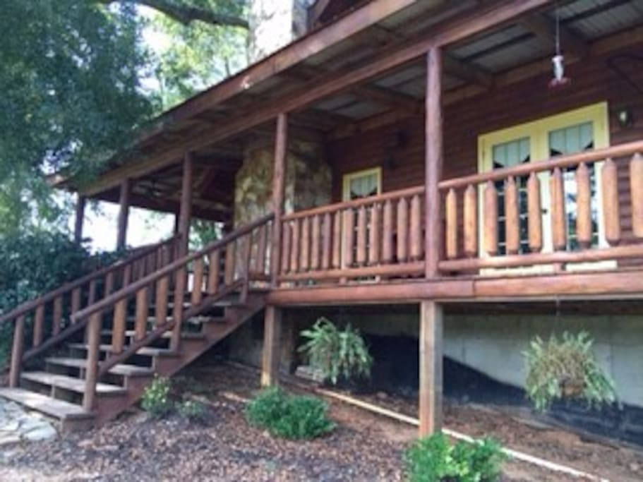 Wrap around porch with steps leading to the pond!