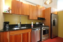 natural cherry cabinets and stainless steel appliances