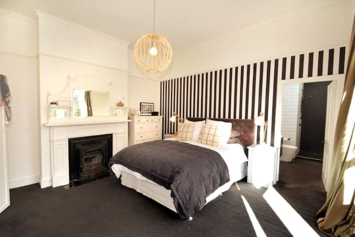 Large spacious master bedroom. Private ensuite with large shower, sink, heated towel rail, toilet. King size bed.  Quality pillow top mattress. All new bedding in place for guest visits.