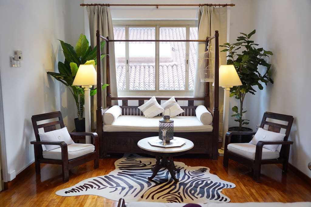 Surrounded by lush plants, our lovely zebra rug adds a touch of exotic fancy to this solid, antique teak wood 4-poster daybed that also sleeps one! Perfect for quiet afternoons reading/lazing by the window. :) We are also able to provide bed linens and pillows for your extra guest should you inform us at the time of your booking ;)