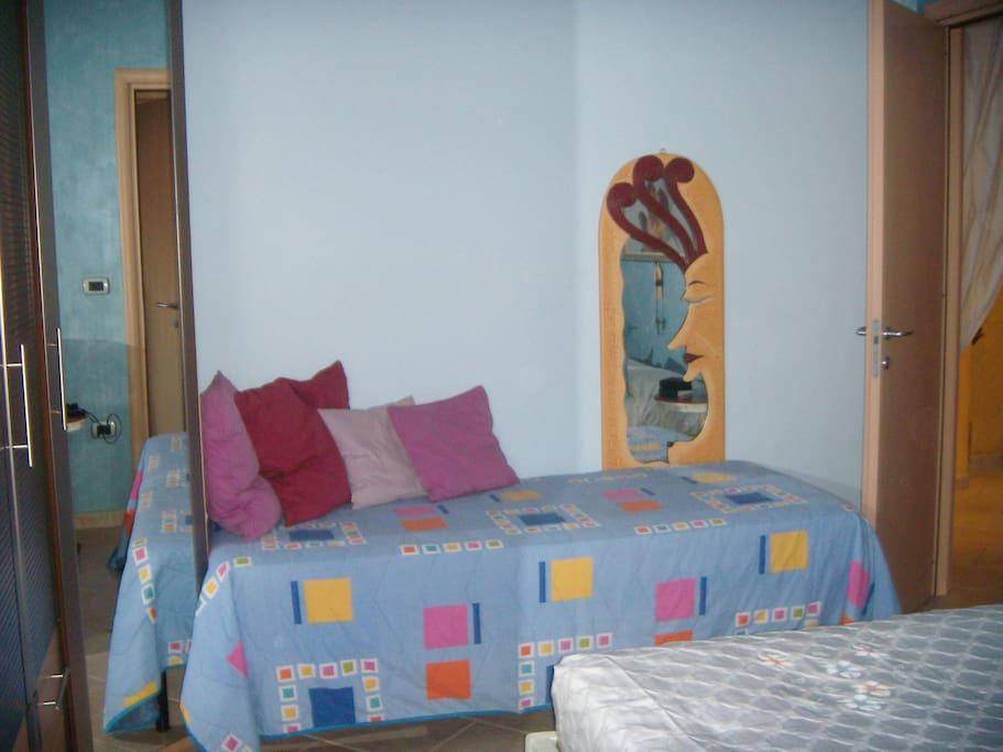 camera da letto 1 tripla