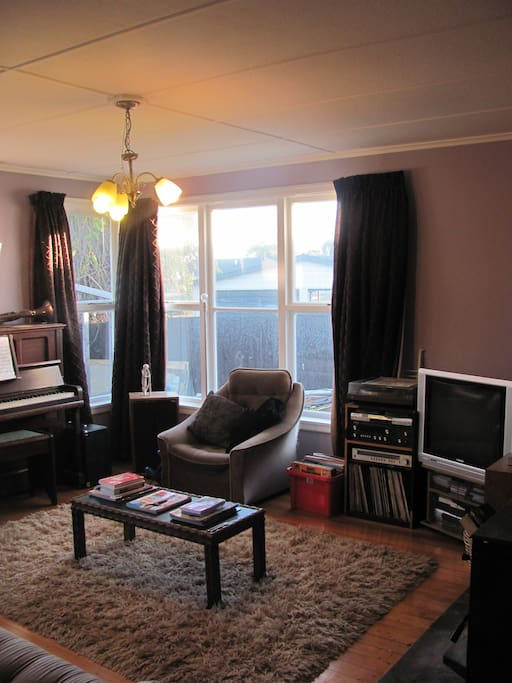 The lounge- access to TV, DVDs, piano, guitar, log-burner