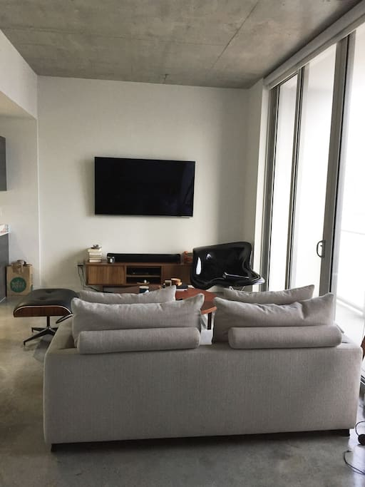 """Spacious living area with a Samsung 65"""" LED HD TV + Apple TV !!!"""