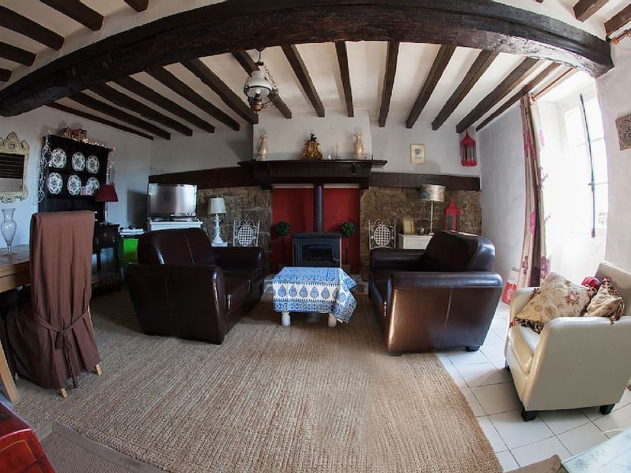 Lovely spacious living room, with leather sofas and dining chairs, iPod player and log burner.