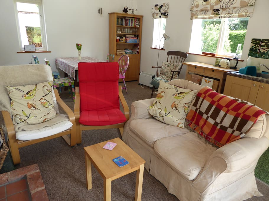 Make yourself at home in the cosy sitting room by the wood burning stove