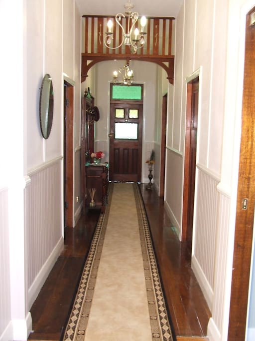 Hallway linking the 3 available bedrooms and the guest lounge area